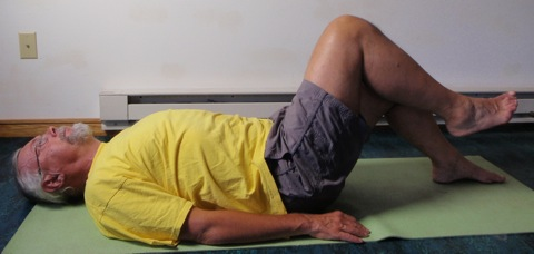 Coach John Hughes demonstrating bent leg raise exercise for core training for cycling