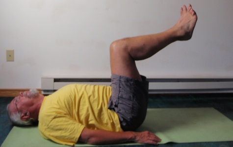 Coach John Hughes demonstrating bent two leg raise exercise for core training for cyclists
