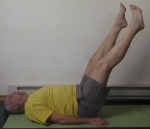 Coach John Hughes demonstrating Pilates circles exercise for core training for cycling