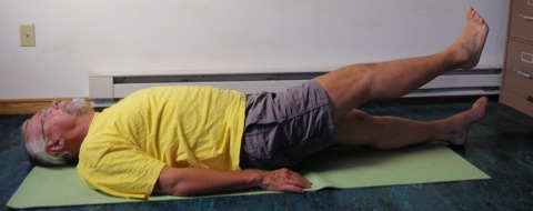 Coach John Hughes demonstrating straight leg raise exercise for core training for cycling