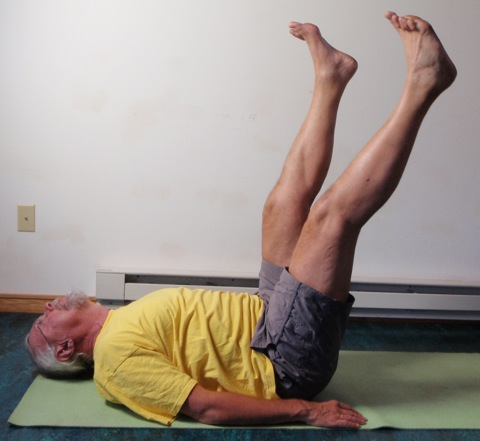 Coach John Hughes demonstrating straight two leg balance exercise for core training for cycling